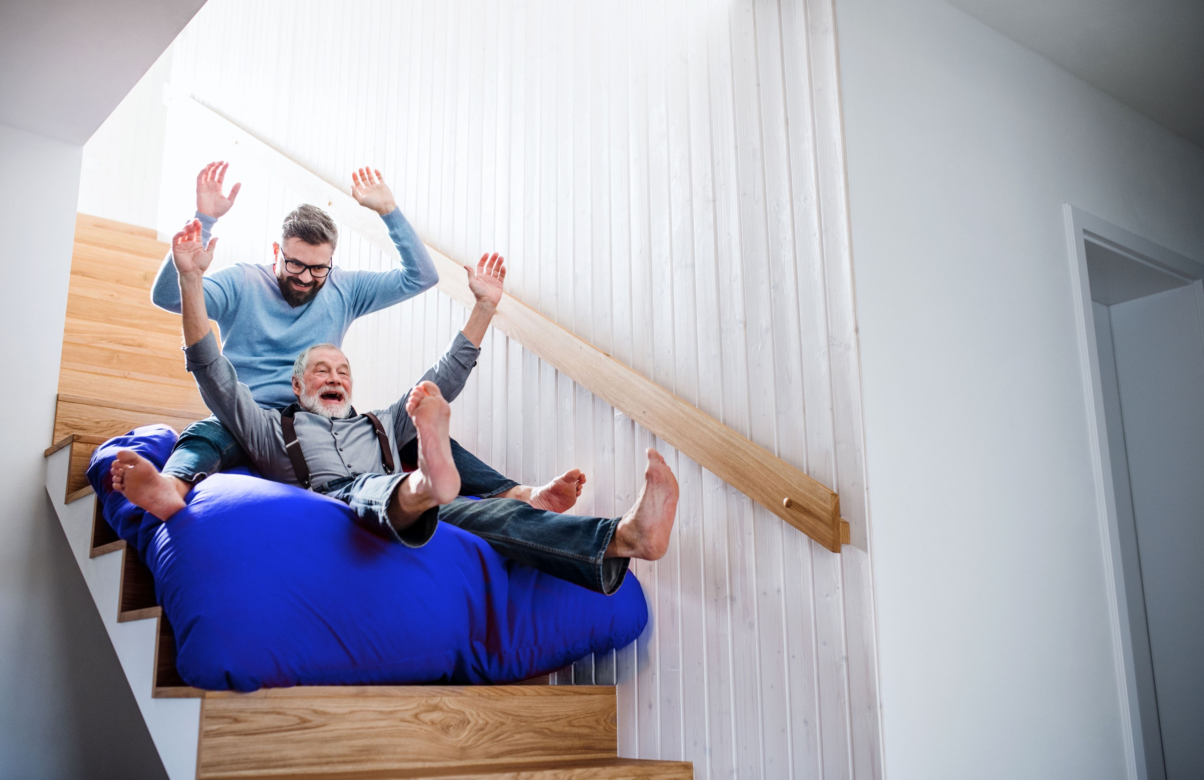 Sledding down stairs. RefiNow Expands Access to Low Mortgage Rates — Are You Eligible