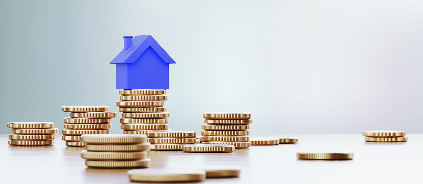 Coins and blue house. Saving for a Down Payment Where Should I Keep My Money?