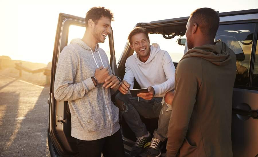 Men laughing in car