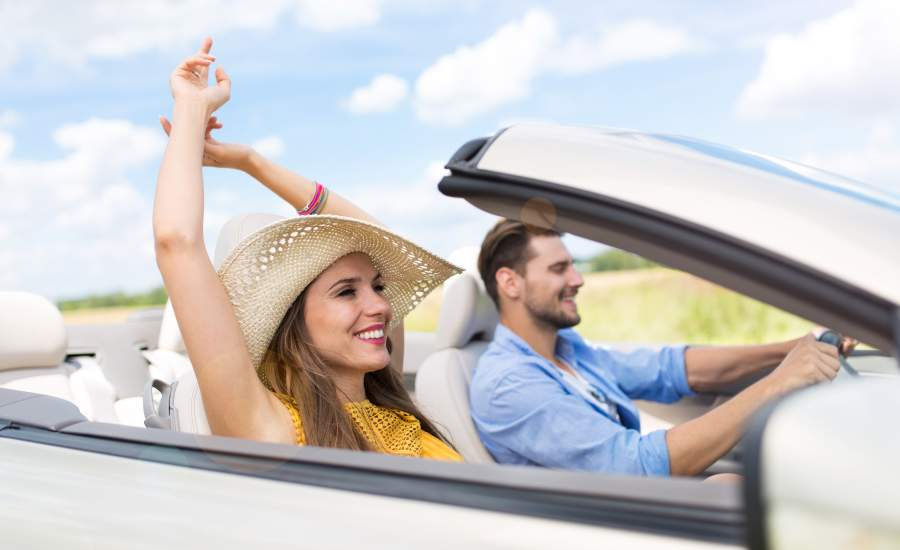 couple in convertible laughing