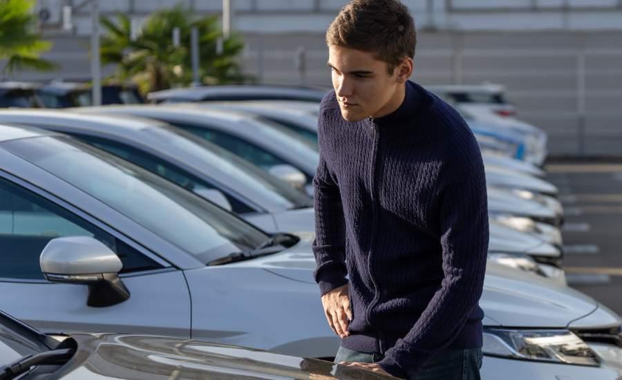 male customer looking at car