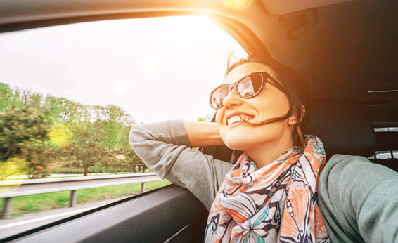 girl laughing out car window