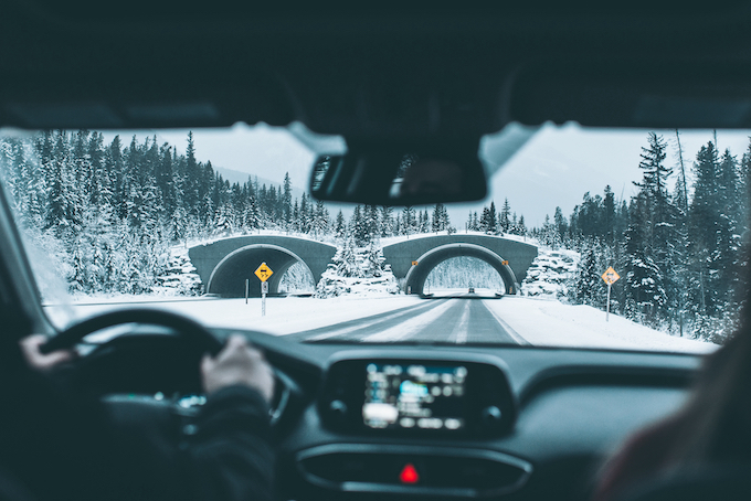 winter driving under bridge