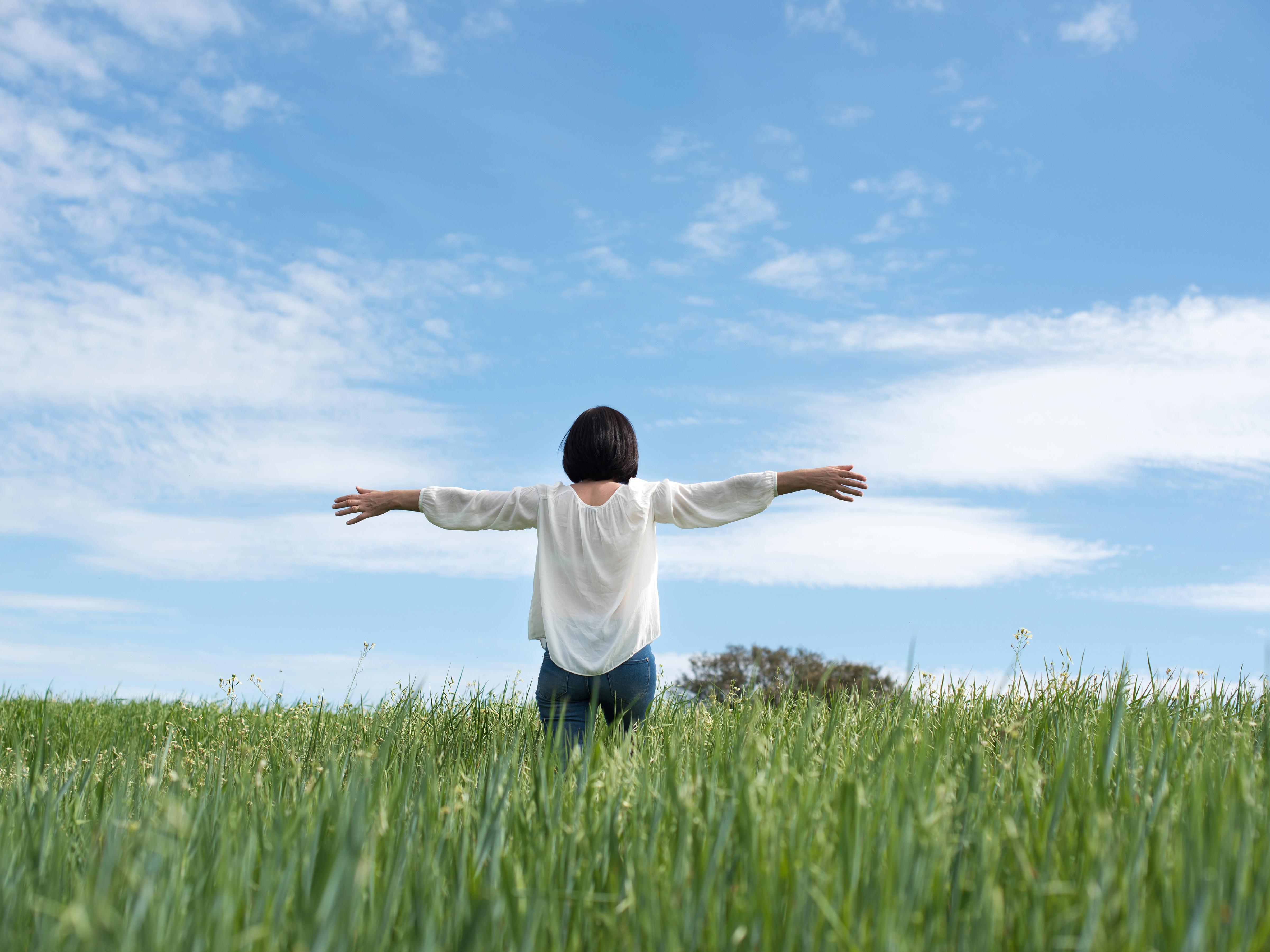 Woman in Green Field, Envato