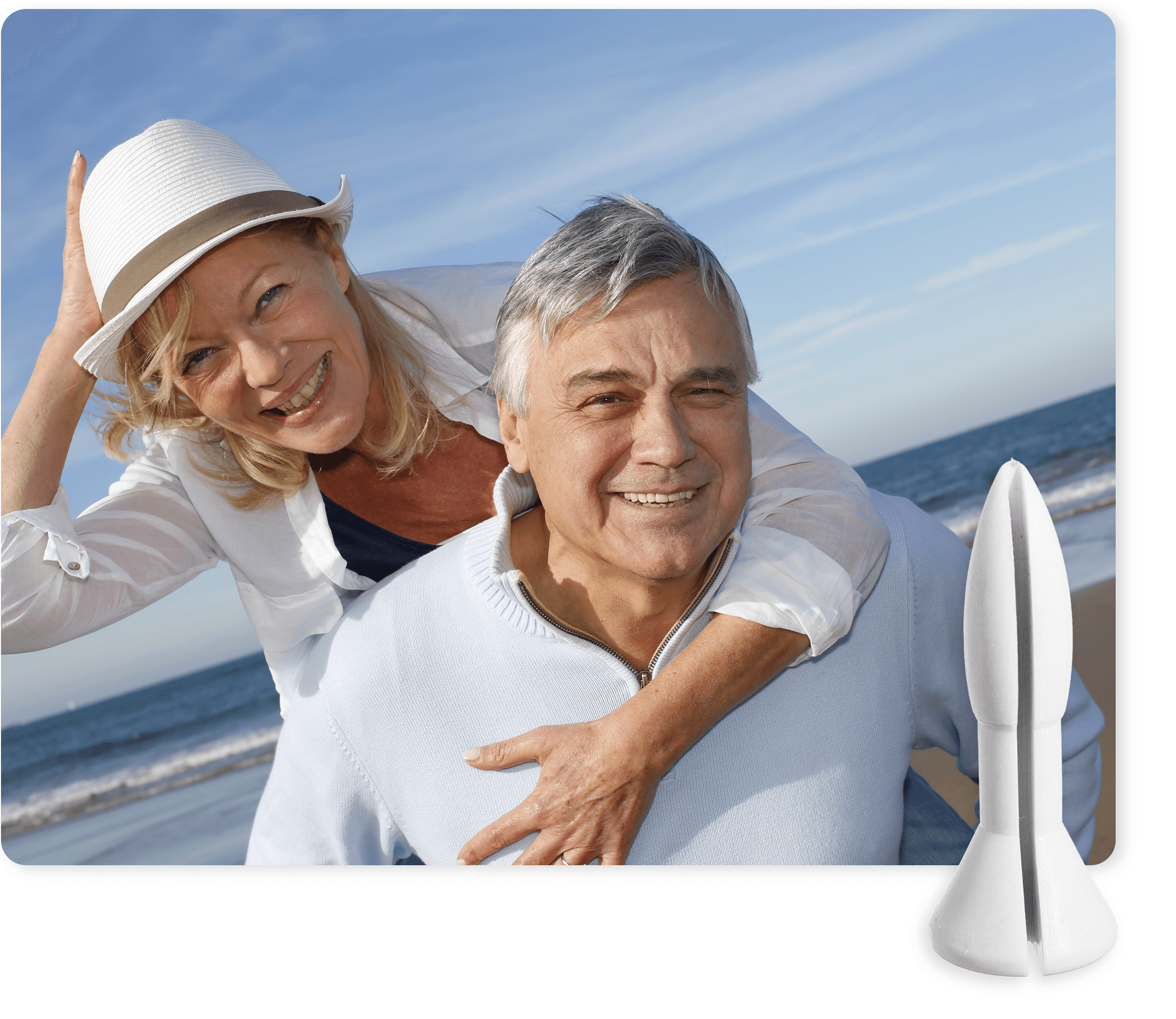 Happy couple looking at the camera on the beach with a Rectal Rocket suppository.