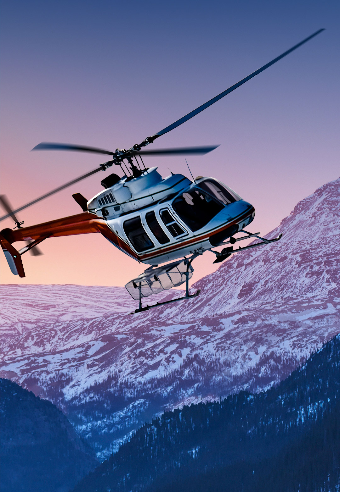 Helicopter flying over a Yukon mountain range at sunrise mobile version.