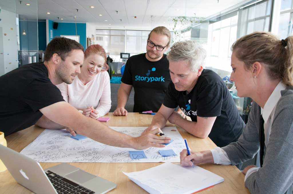A group of colleagues working on a plan together