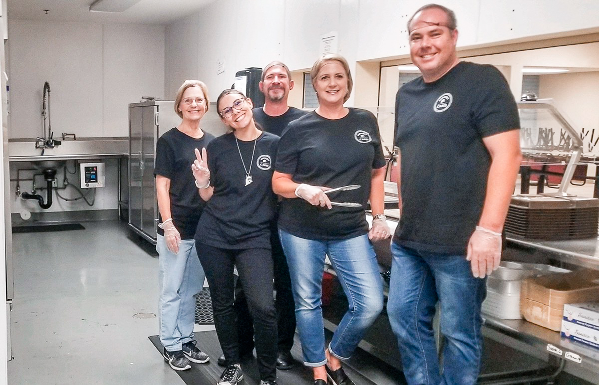 five SunWest employees volunteer with SunWest Cares to serve lunch over the counter at U Mom in Phoenix