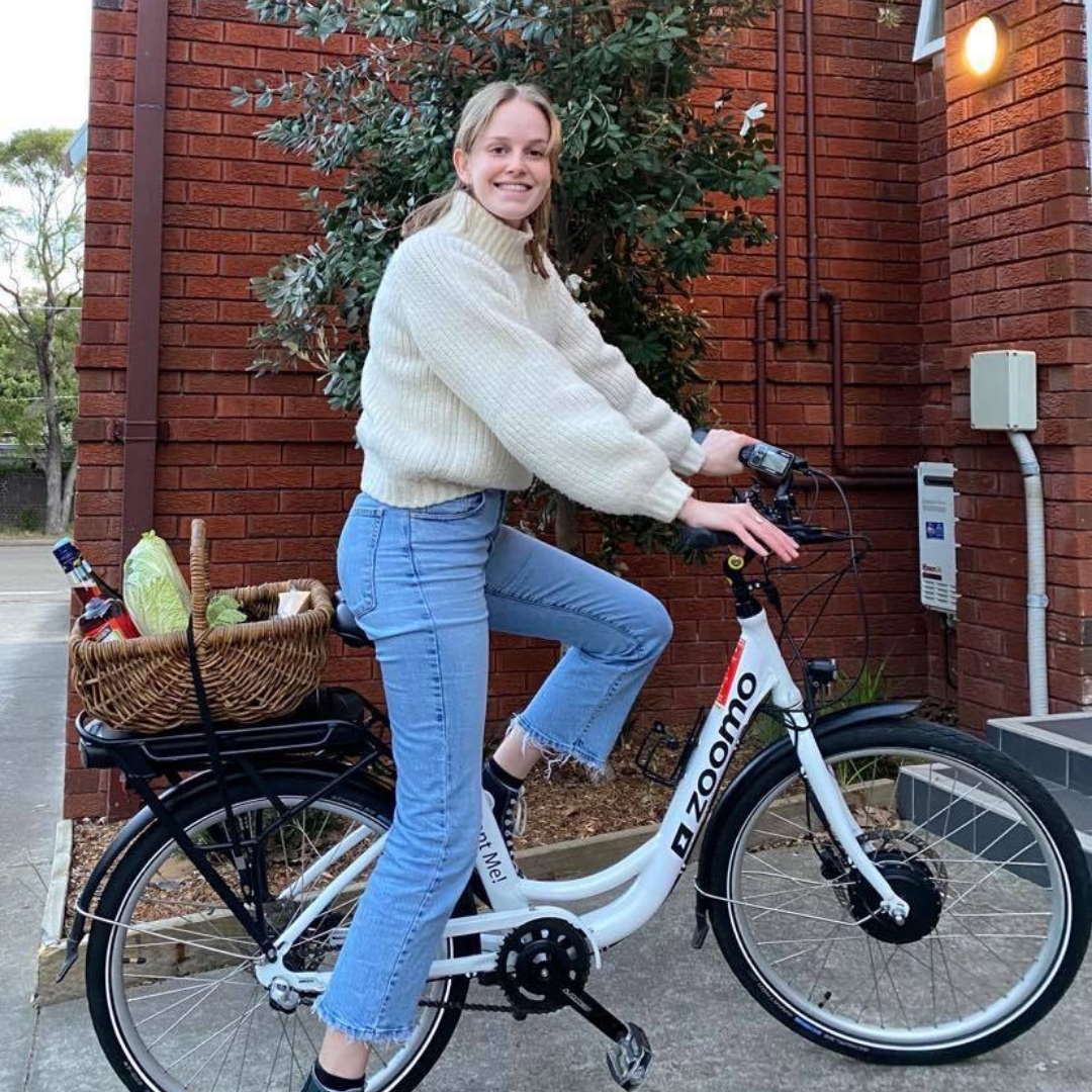 Woman riding an electric bike to do her grocery shopping