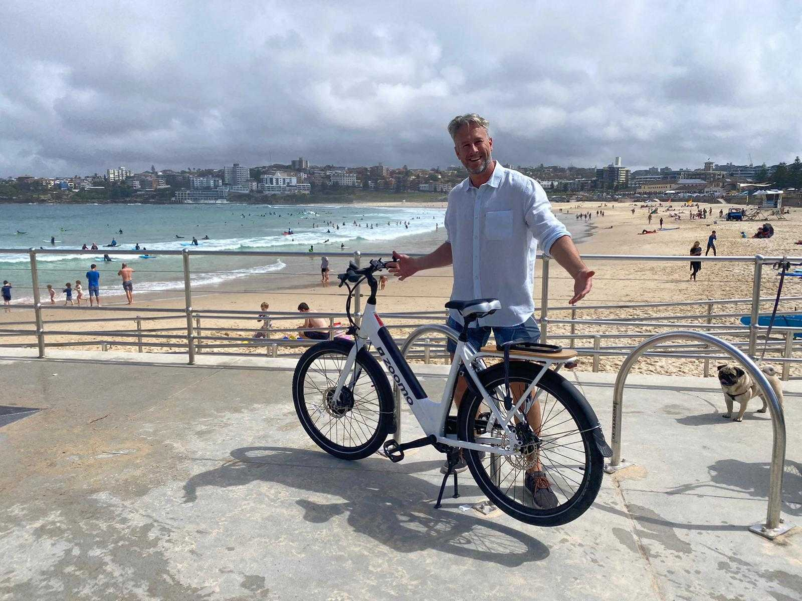 Man riding an electric bike to the beach