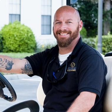 GoldOller Service Manager Chris Shelton on golf cart