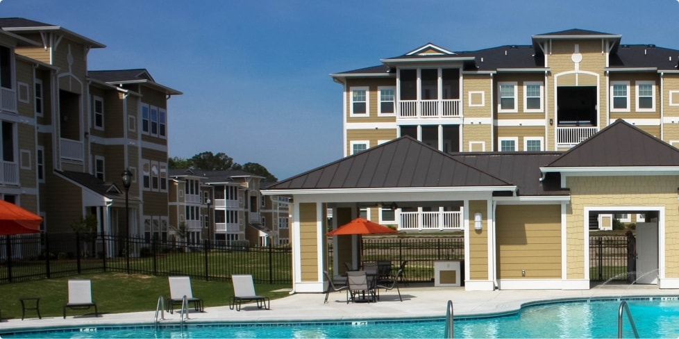 Community pool in center of Maxus Properties multifamily apartment complex