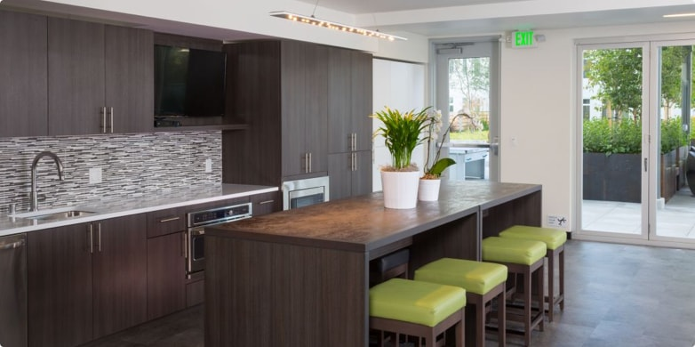 Community dining room and kitchen room at Tarragon property