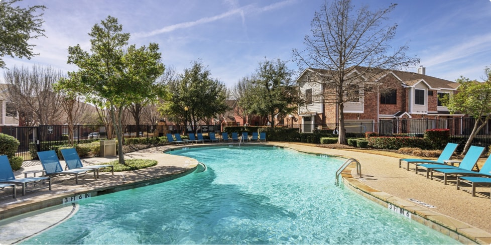 Pool and lounge chairs at Steadfast multifamily complex