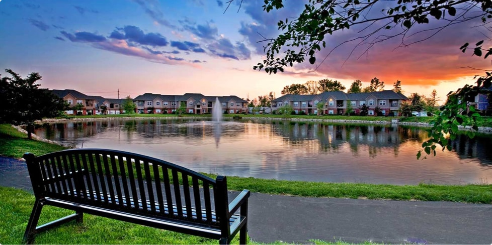 Bench overlooking man-made lake at center of Steadfast multifamily complex
