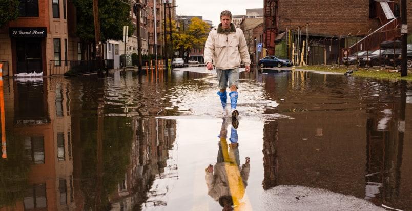 man facing hurricane
