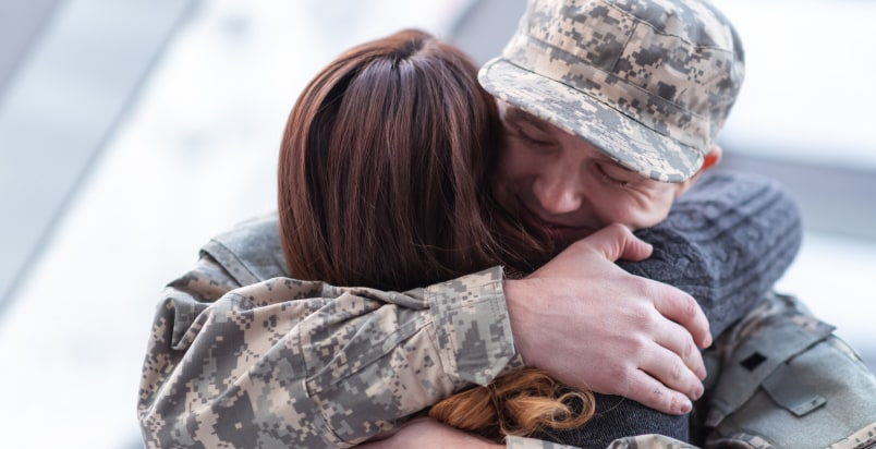 military couple embrace