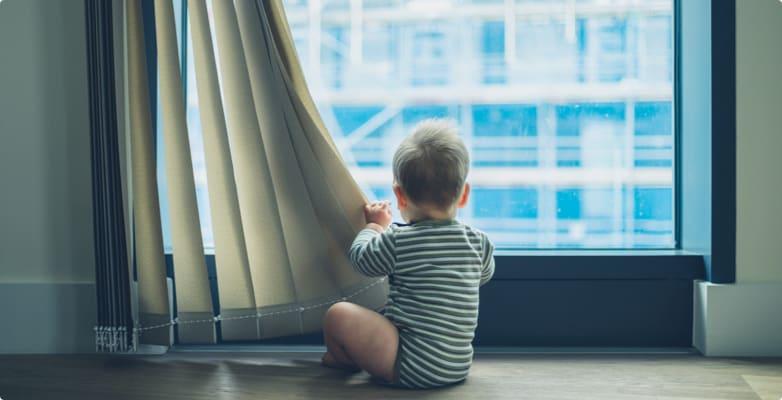 baby near curtains