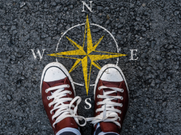 Person standing on a picture of a compass