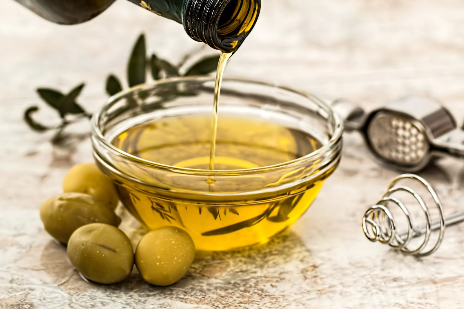pouring olive oil on a saucer