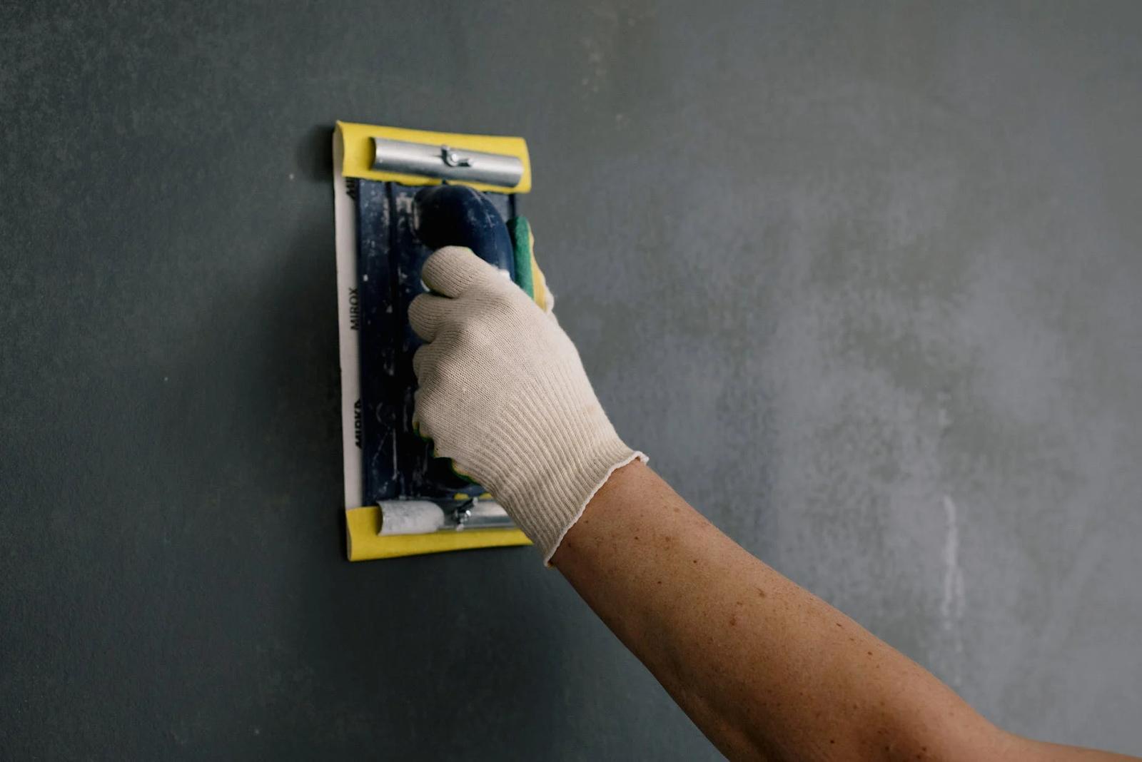 applying wood filler on wall