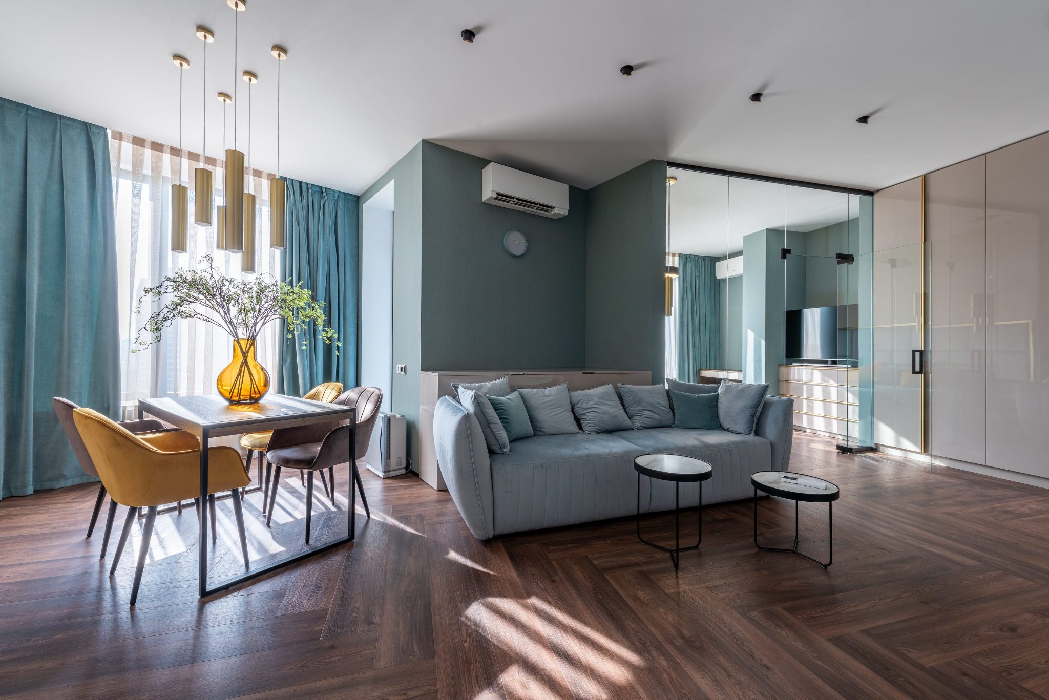 Predominantly light blue living room with dark brown parquet flooring