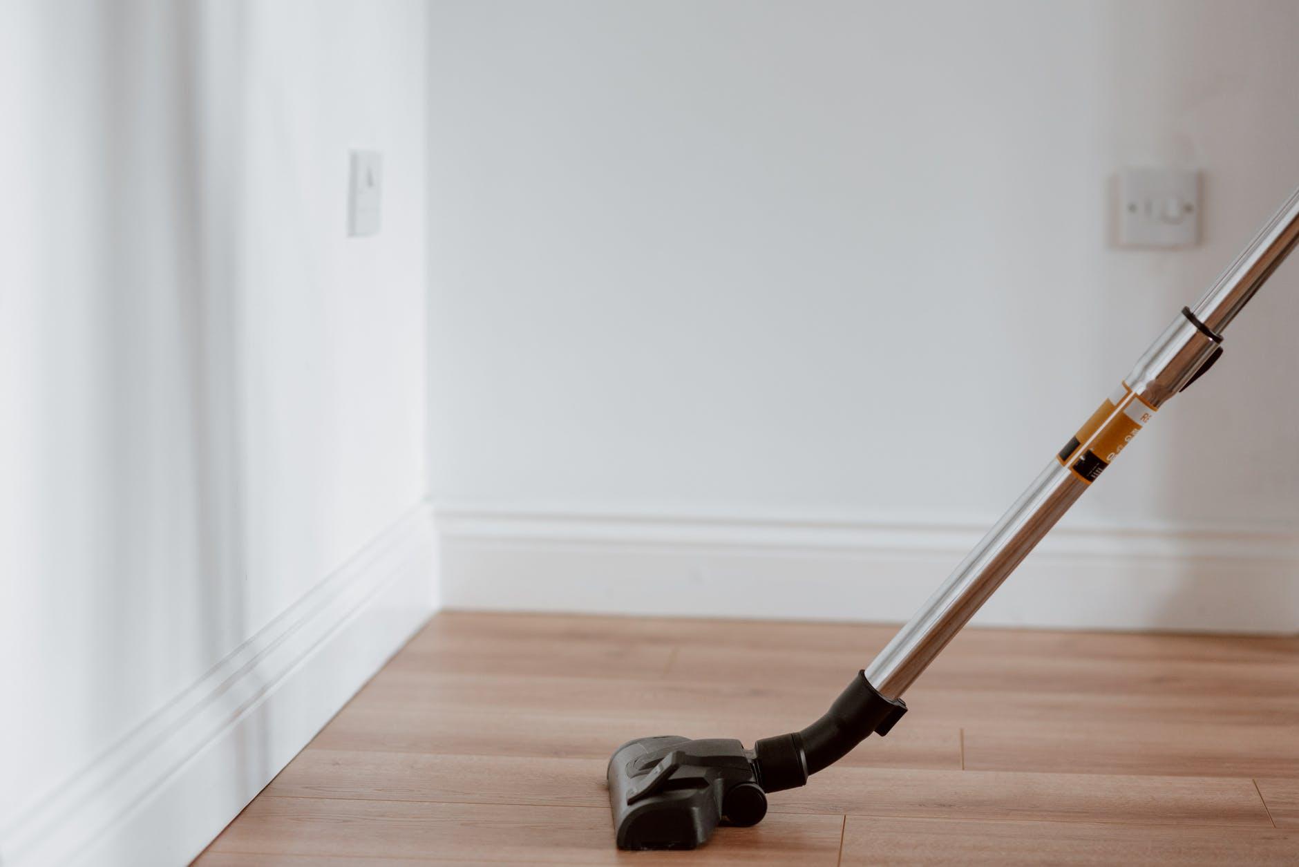 Stick vacuum on light wooden floor