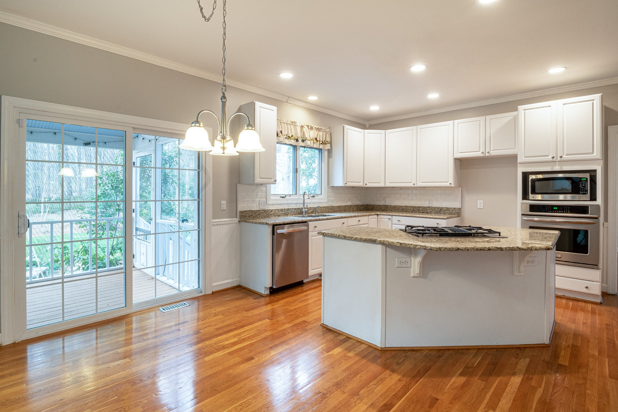 White walled kitchen with vanished wooden flooring