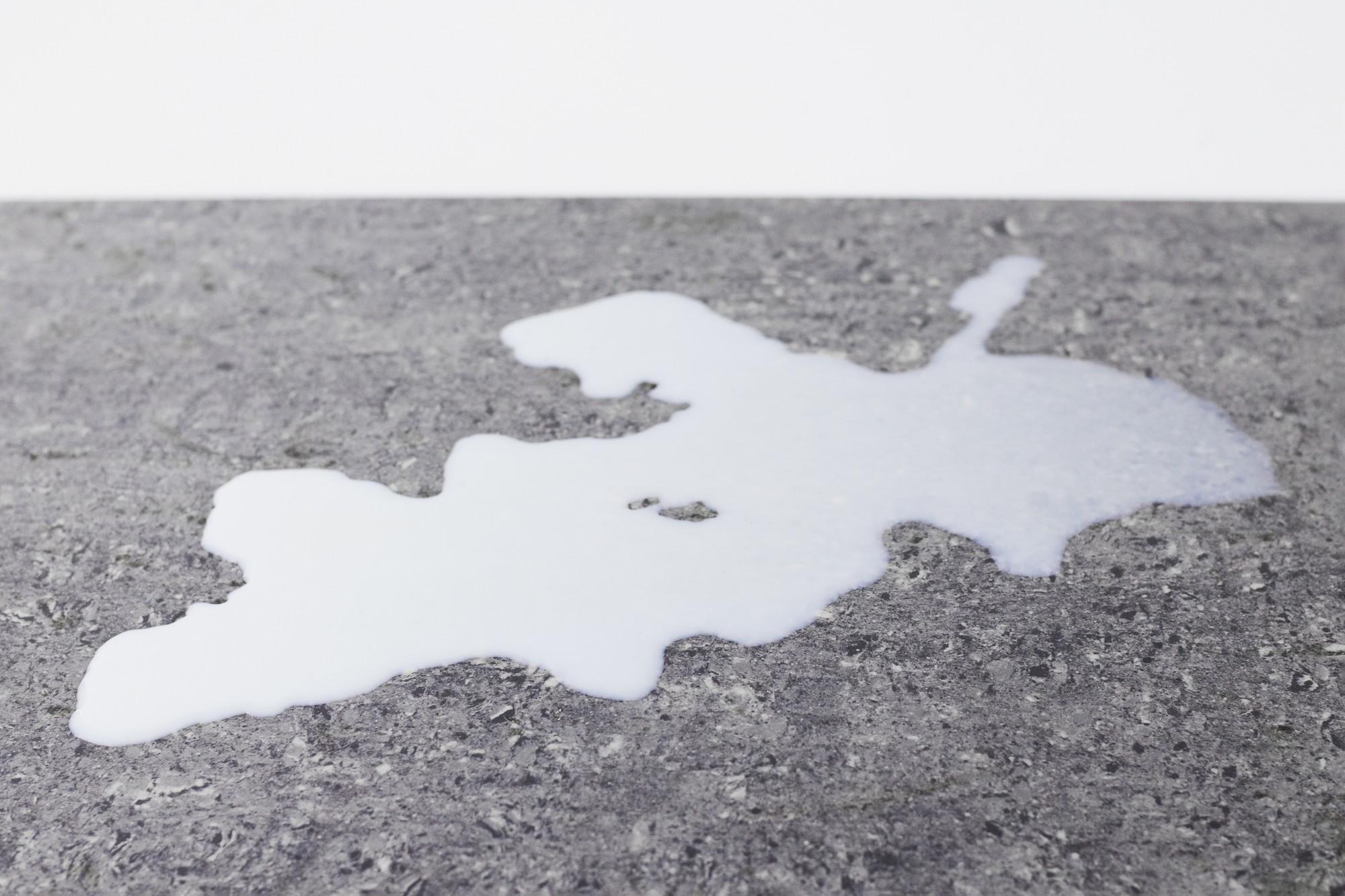 milk spilled on textured surface