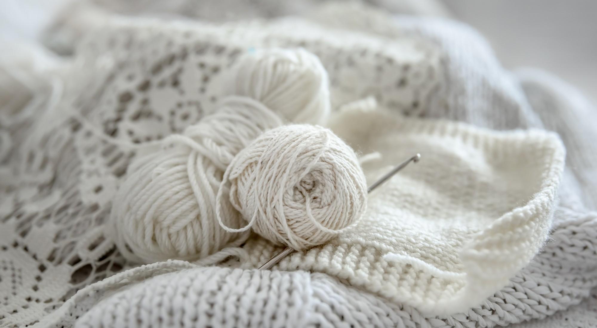 Ball of yarn on crochet yarn rug