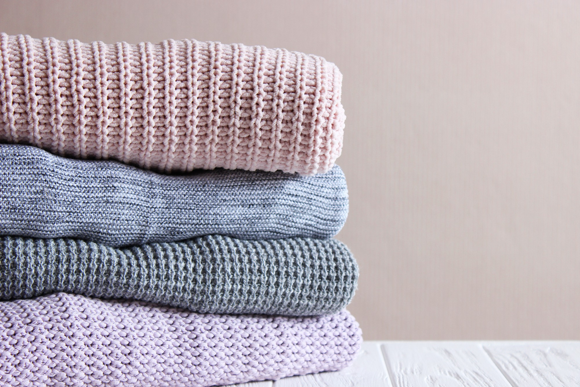Folded and stacked knitted rugs