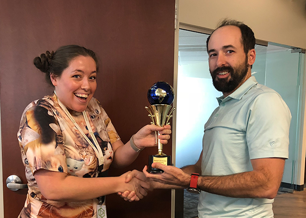 Kelli recieves the first annual McCormick cup for Geotrivia