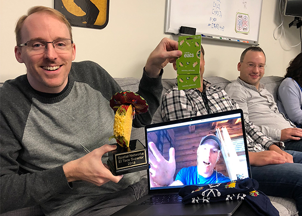 Tim presents Jason with his trophy remotely