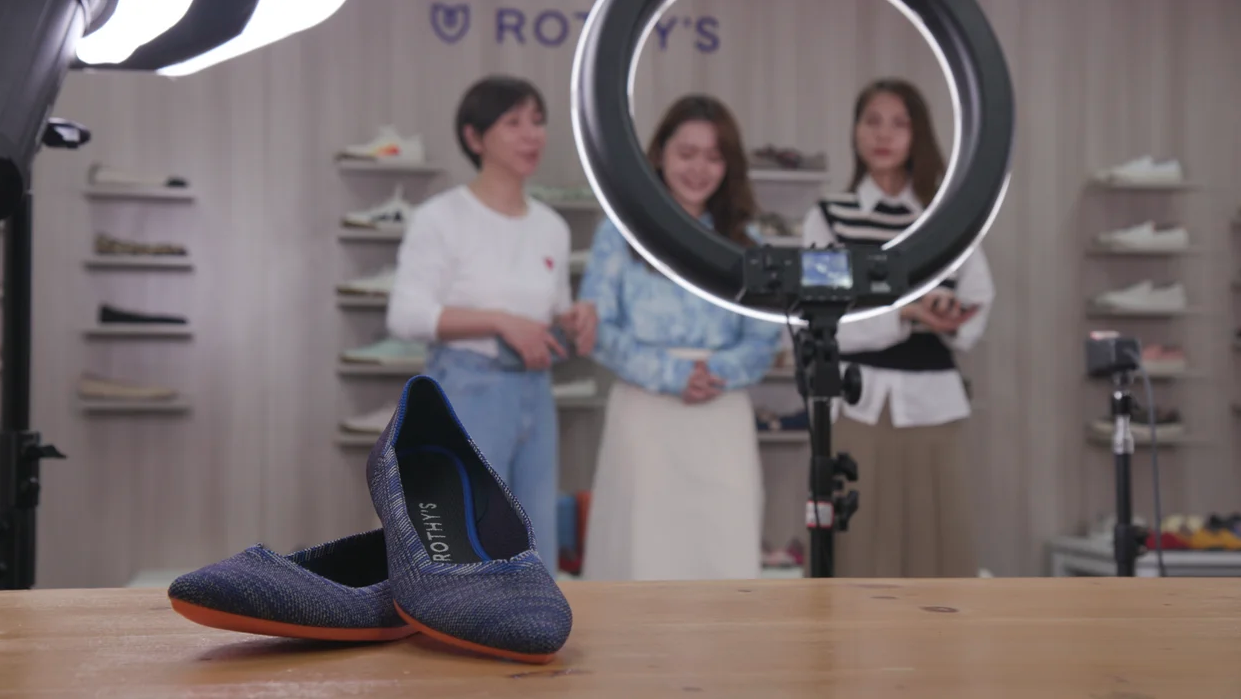 Rothy's team records a video for Alibaba with their branded shoes in the foreground