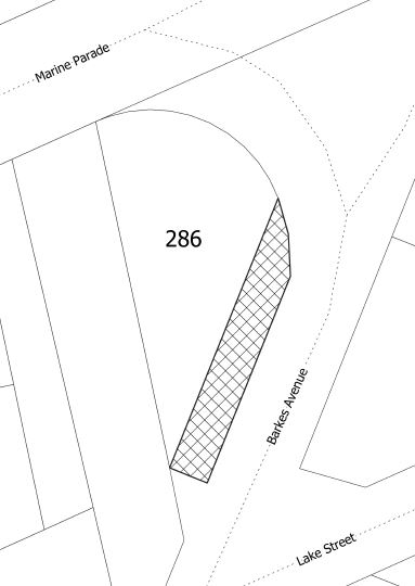 Aerial map showing outlines of roads, with a section coloured in to show the land for sale.