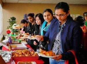 Students enjoying a large potluck.