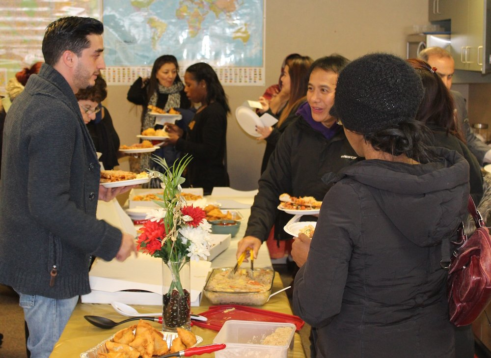 People enjoying a large buffet of food.