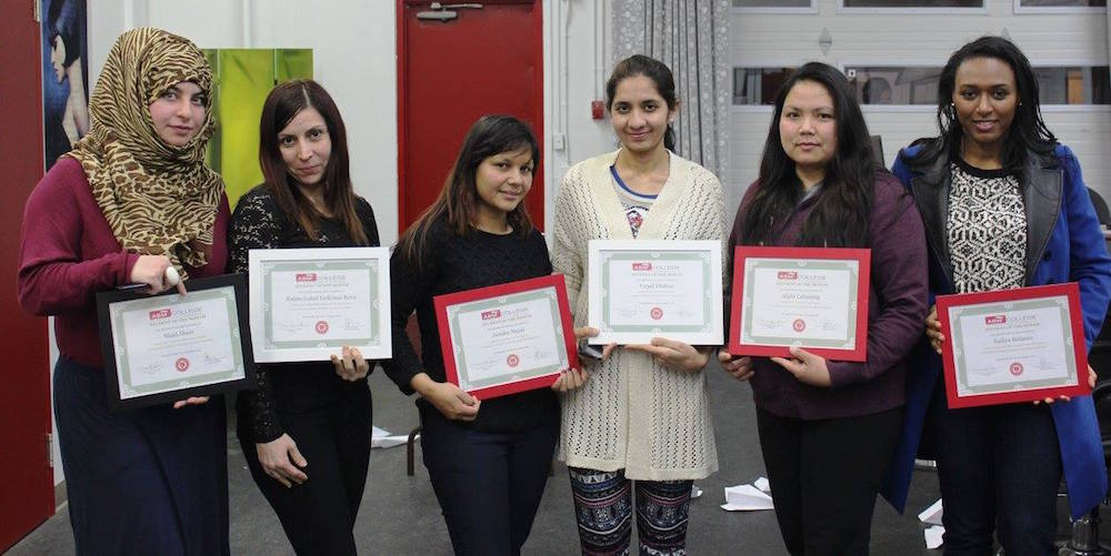 Group of women with certificates.