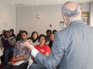 School president talking to students.