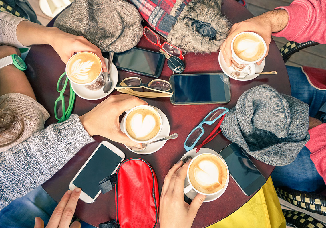 Coffee and phones on the table