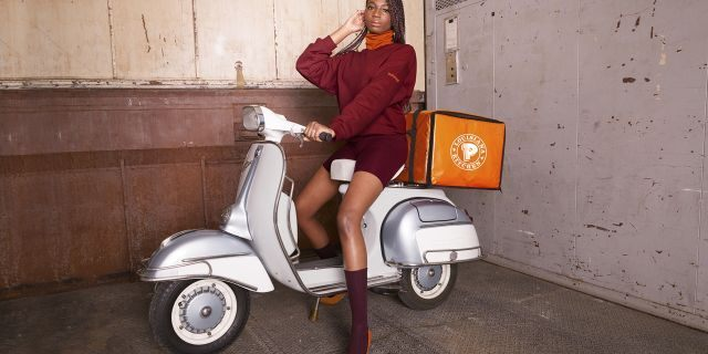 "Popeyes has taken it upon itself to offer its own ten-item collection that features ""some of the brand's most iconic maroon and orange uniform designs."""
