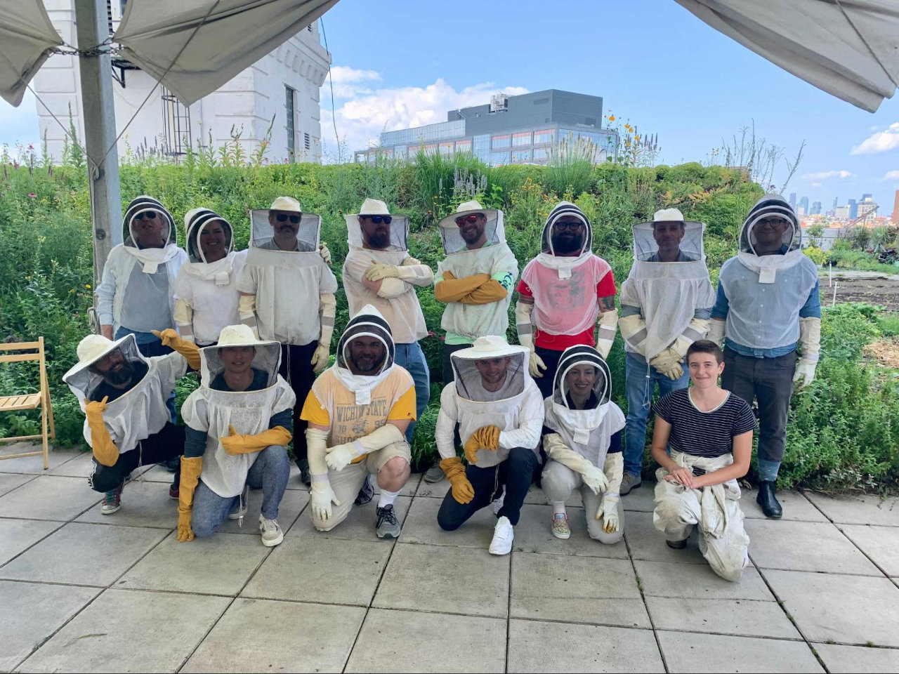 strongDM team in New York with honey bees