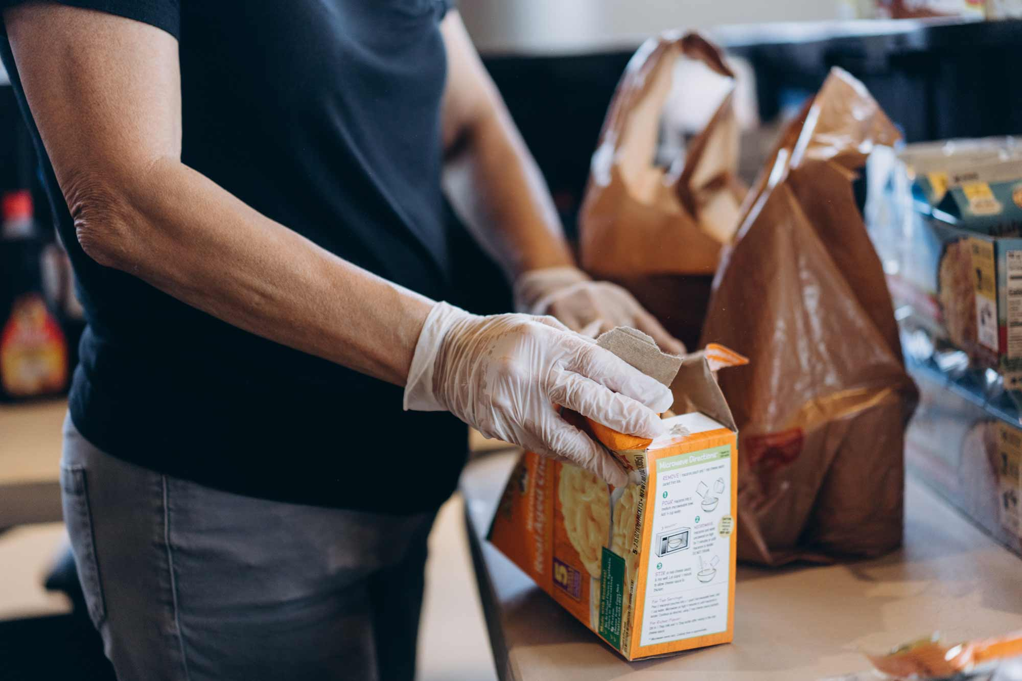 Woman packaging food into a bag
