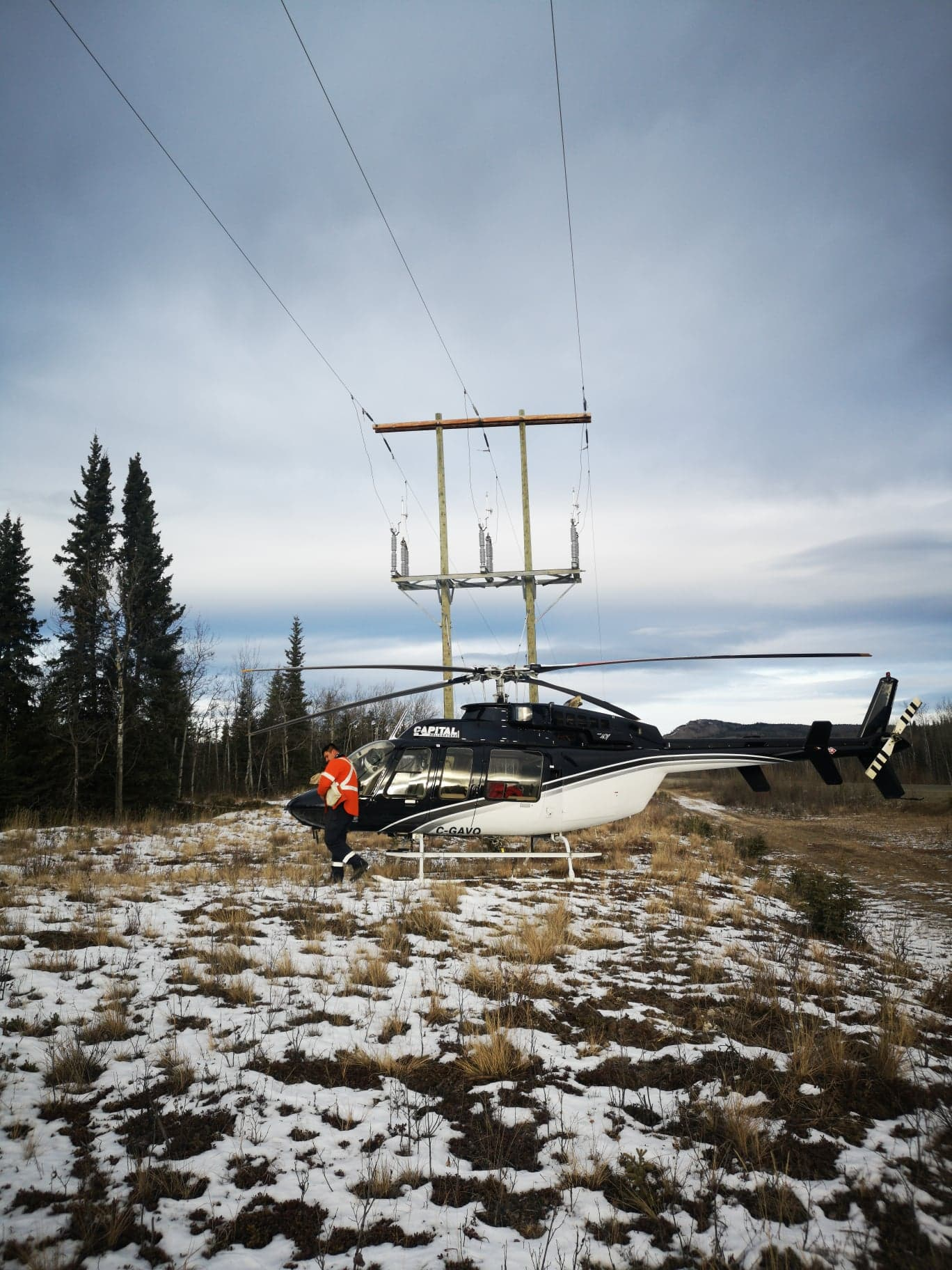 Capital Helicopters transporting crew to cellphone tower for maintenance.