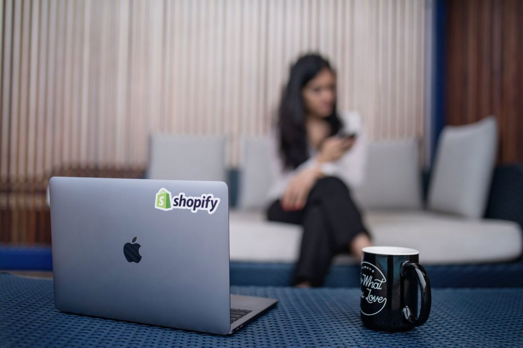 laptop-with-shopify-sticker