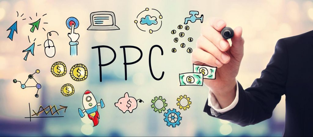 man drawing cartoonish icons related to PPC