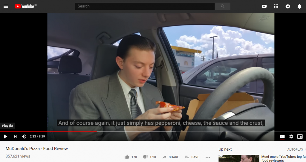 screenshot of youtube video of a person doing pizza review