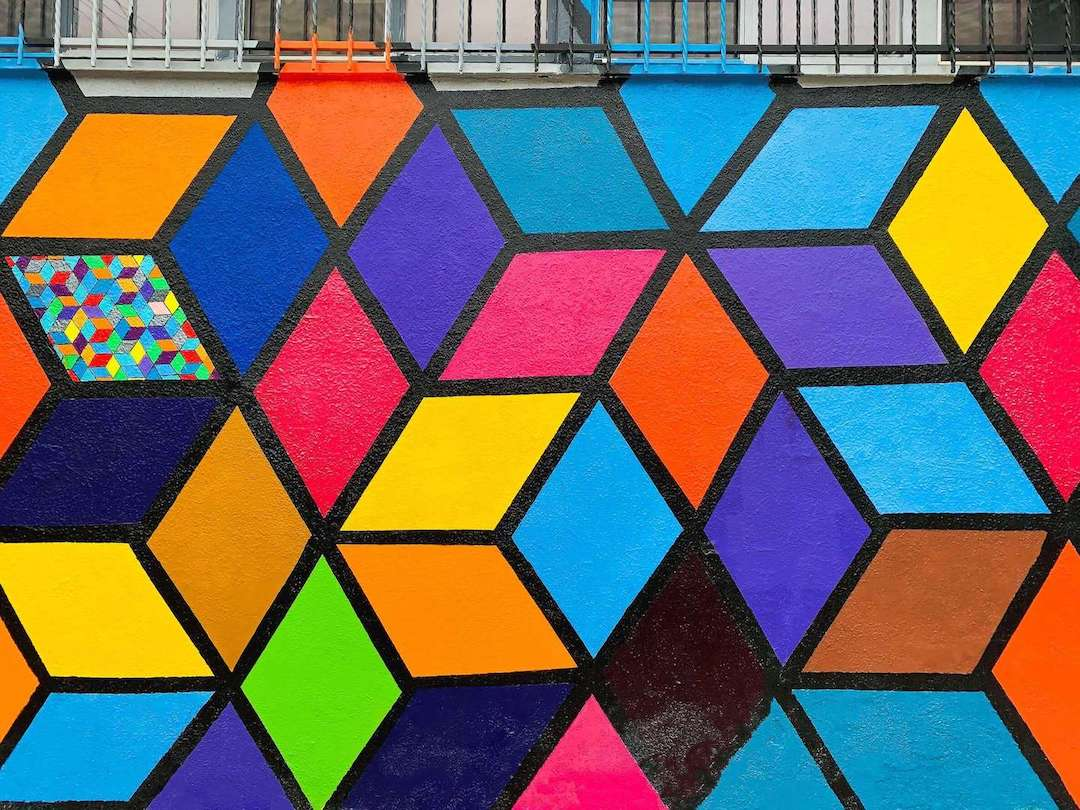 Colorful geometric shapes painted on a wall