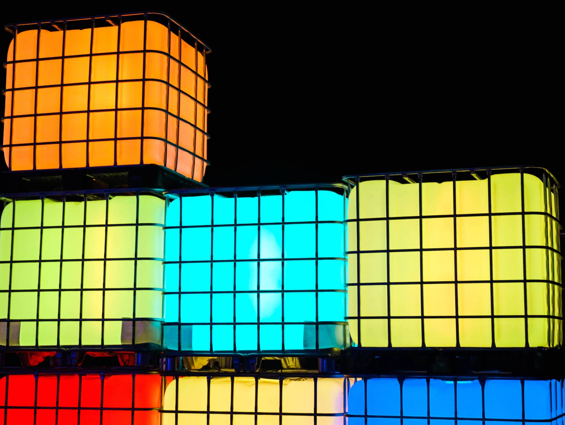 Large lighted cubes in cages