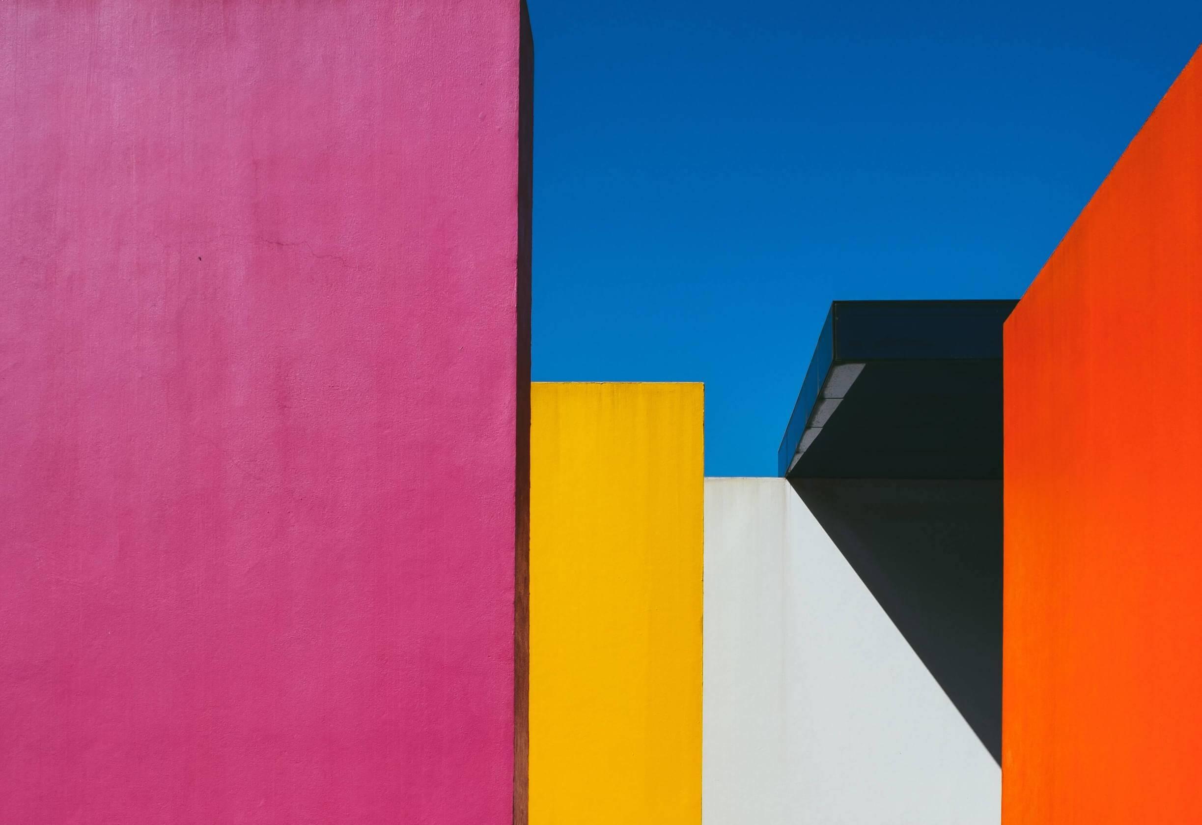 Colorful, modern buildings that evoke the art of Piet Mondrian set against a blue sky